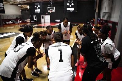 (Photo Credit: Jon Lopez / Jon Lopez Creative) Local D.C. coach gathers her team for a pregame prep talk