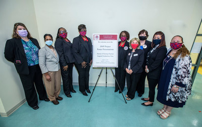 From left to right: Doris Thornhill, DNP Candidate; Sara Bashyam, DNP Candidate; Tracie Barber, DNP Candidate; Carol Anderson, DNP Candidate; Dianna Moorer, DNP Candidate; Dr. Melanie Michael, Director of the Graduate Nursing Program; Dr. Tracy Magee, Assistant Professor of Pediatric Nursing and Education Coordinator; Kristen Milinazzo, DNP Candidate; Elizabeth Palazzi-Xirinaches, DNP Candidate.