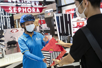 A Dada Now rider takes online orders for delivery at a Sephora store in Shanghai, China